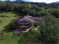 Beautiful Lucero Golf Course House for Sale in Boquete on A Lovely Acre of Landscaped Property